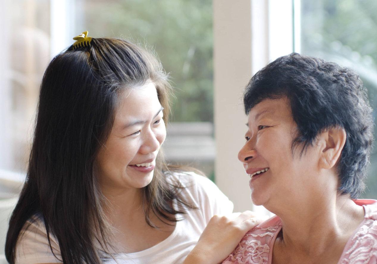 caregiver and patient having fun